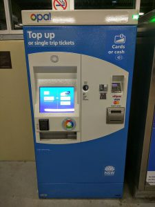 A second generation Opal card top up ticketing machine. Image by user Maksym Kozlenko, licensed by CC BY-SA 4.0.