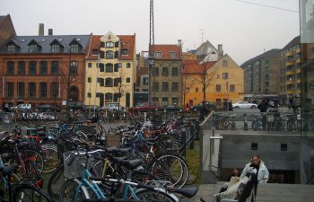 Bicycles parked outside of the Christianshavn Metro Station in Copenhagen. Image by user Boeing720, licensed by CC BY-SA 4.0.