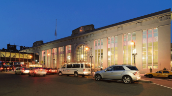 A street view of Newark Penn Station at dusk. Image by user King of Hearts, licensed by CC BY-SA 3.0.