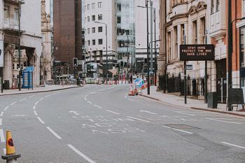 Photo of an empty street in Leeds, UK by Dan Burton on Unsplash