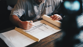 An architect at work, by Daniel McCullough on Unsplash