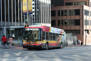MDOT MTA Coach #16002 at Charles Street & Fayette Street on CityLink Silver. By Bereal123 - Own work, CC BY-SA 4.0, https://commons.wikimedia.org/ w/index.php?curid=69659870