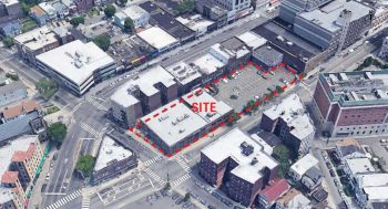 """image of a long, rectangular parcel, half of which is developed low-rise, the other half of which is parking. A red overlay reads """"Site"""""""