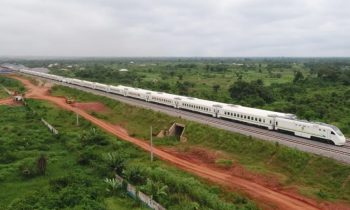 Image of white train on newly constructed track