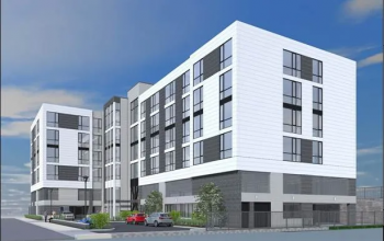Rendering of a white and gray blocky seven story housing development. Cars are parked in front.