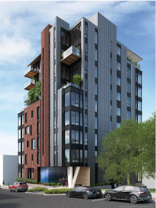 Image of a nine story tall residential building, blue and a rust-colored red.