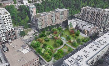 Around a green space, renderings of mid-rise apartment buildigns are shown. To the right, one can see a Hudson Bergen Light Rail train