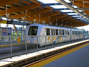 A white, two car train, the Vancouver sky train