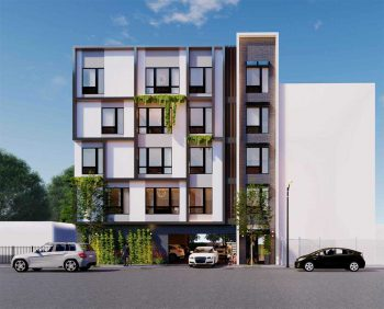 A modest, five story development, white and gridded with greenery hanging out of several windows.