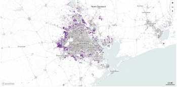 A white map shows in purple the sprawl of Houston, Texas from the past two decades, it is expanding outward