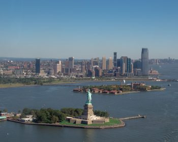 The statue of liberty, and Jersey City's skyscraper skyline behind it