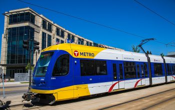 A blue and gold Metro light rail in Minneapolis