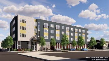A rendering of a four story mixed-use housing development, painted gray and yellow